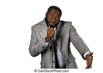 Black stand-up comedian. Darkskinned comedian perfrorming....