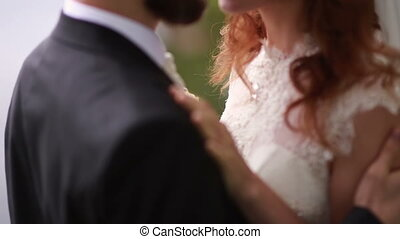 bride and groom hugging outdoors in the park. - bride and...
