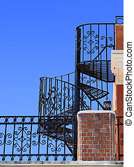 Wrought iron spiral staircase - Worm-eye view of an old...