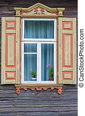 window with shutters farmhouse and a flower on the windowsill