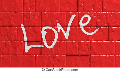 Red painted brick wall with Love word graffiti