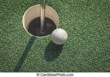 Golf ball on the hole