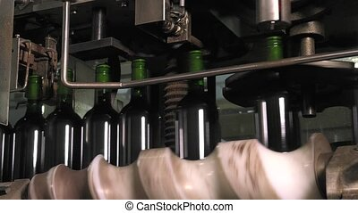 Bordeaux Saint Emilion bottling - setting up capsules with...