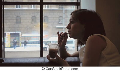 Snowy weather and hot chocolate - Girl drinking hot...