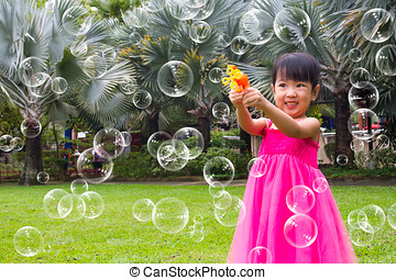 Asian Little Chinese Girls Shooting Bubbles from Bubble...