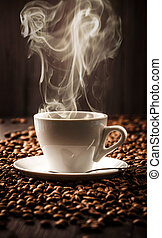 Hot cup of coffee on beans background - Cup fragrant coffee...