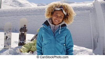 Cute skier in front of friend in snow - Cute skier with...