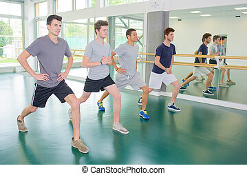 young men stretching