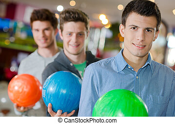 men with bowling ball