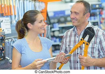 Man and woman in hardware store