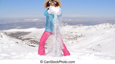 Happy adult in ski clothes waving arms - Happy beautiful...