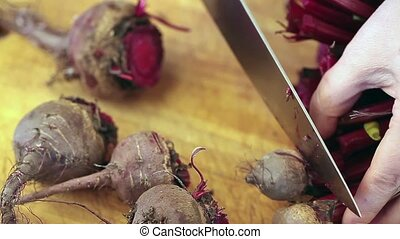Cut Beetroots - Cut fresh beetroots on wooden board.