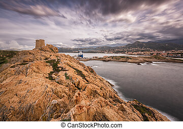 Genoese tower at La Pietra in Ile Rousse in Corsica -...