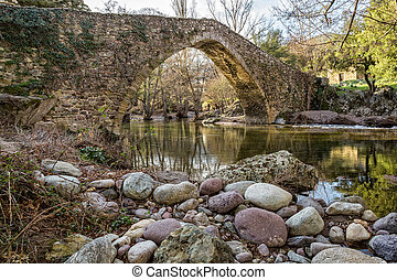 Genoese bridge at Piana in Corsica - Stream passing through...