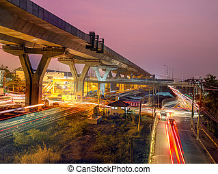 Express way construction site over road with ligh of traffic...