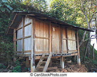 Old wooden barn of Thai hill tribe people on the mountain, Chiang Rai Thailand