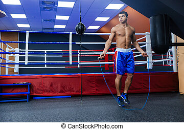Boxer jumping with skipping rope - Full length portrait of a...