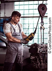 Automotive technician repairing engine - Image of automotive...