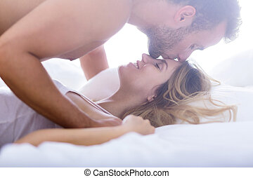 Kiss in forehead - Handsome man giving kiss in his...