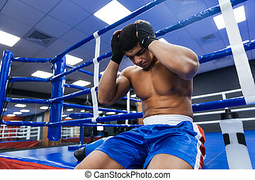 Boxer resting in gym - Handsome male boxer resting in gym
