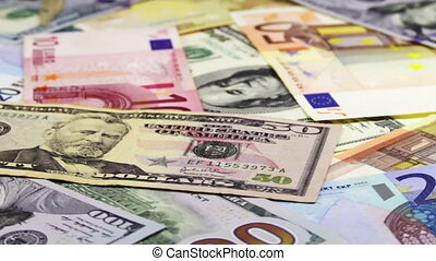 Dollars and Euro Banknotes Rotate