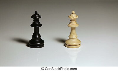 Hand knocking over chess pieces - Close up of single hand...