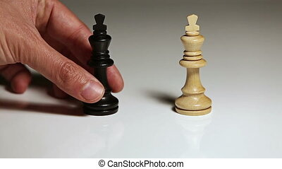Hand putting down chess piece - Close up of single hand...