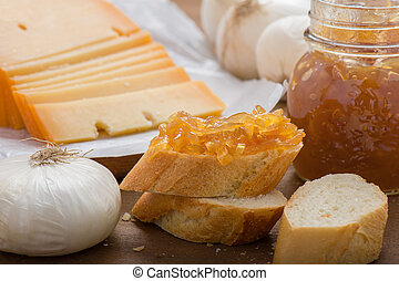 Onion marmalade on bread with sliced cheese