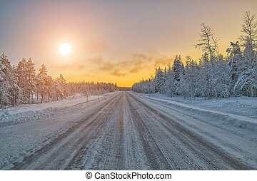 Colorful Lapland arctic day on winter road, Finland -...