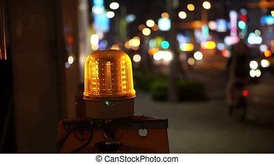 Construction light in city night