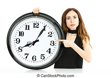 Woman pointing to clock