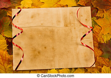 Old vintage blank sheet of paper on colorful maple leaves. Thanksgiving, autumn.
