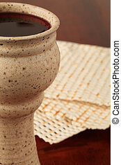 Celebrating Passover - Chalice with red wine and unleavened...
