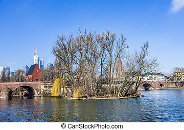 skyline of Frankfurt an Main with old historic bridge at...