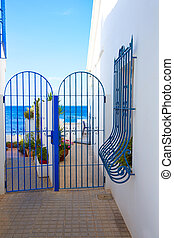 Denia Mediterranean blue houses in Las Rotas at Alicante...
