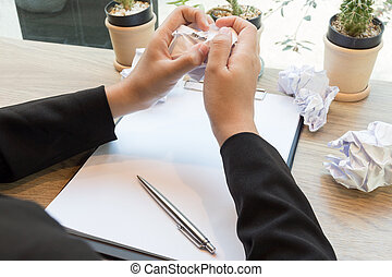 Hands of woman crumple sheets of Resume at the desk, mistake resume