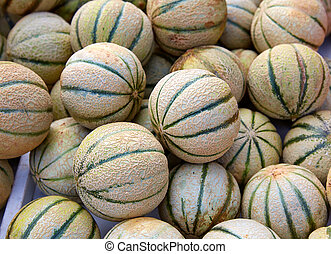 Cantaloupe melons at the marketplace stacked