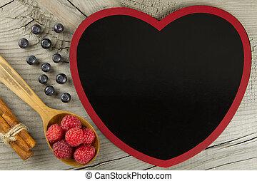 Blueberries and raspberries with cinnamon sticks on wooden . Healthy vegetarian food, diet.