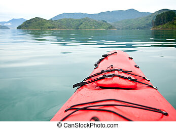 Red touring kayak - Sea kayaking in the Marlborough Sounds,...