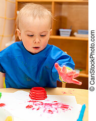 Child painting with hand - Little girl make finger paint