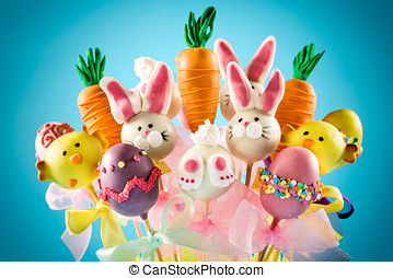 Easter cake pops concept on blue background