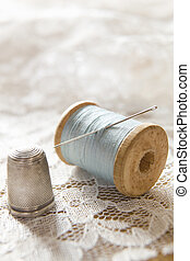 Vintage Cotton Reel With Needle And Silver Thimble On Lace -...