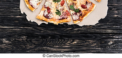 delicious pizza with text space on dark background top view