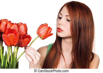 Beautiful and attractive young adult girl with the bouquet of red tulips flowers isolated on a white background