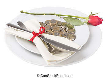 Plate with coins knife and fork over white