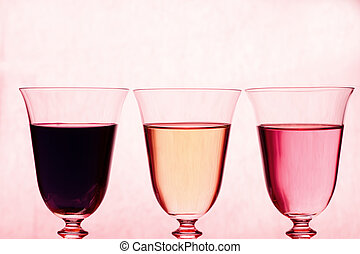 Glasses with red, rose and white wine