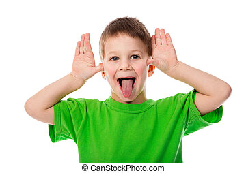 Funny little boy teasing with hands and tongue, isolated on...