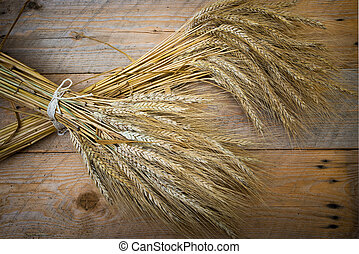 sheaf of barley on the old wooden plate