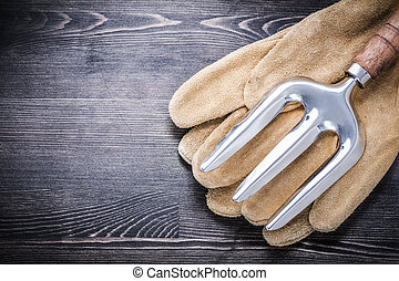 Stainless trowel fork leather protective gloves gardening concep