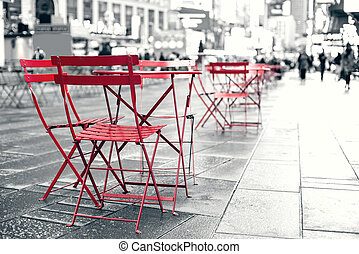 Seating area at plaza in busy Times Square NYC.
